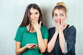 Two Beautiful And Young Girlfriends Women Gossip. The Concept Of Eavesdropping And Gossip poster
