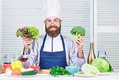 Man Cook Hat And Apron Hold Broccoli. Organic Vegetables. Healthy Nutrition Concept. Bearded Profess poster