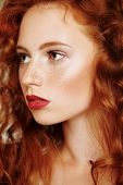 Close-up portrait of a beautiful young woman with long red hair. Hair care, hair coloring. poster