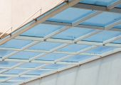 stock photo of canopy roof  - Modern plastic canopy on the building wall.