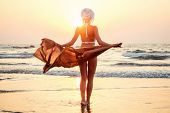 Sexy And Beautiful Young Woman In A Turban And Swimsuit With Luxury Shawl Pareo Chiffon Dress Develo poster