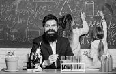 Fascinating Biology Lesson. School Teacher Of Biology. Man Bearded Teacher Work With Microscope And  poster