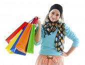 stock photo of muslimah  - Pretty young muslim woman holding shopping bags - JPG