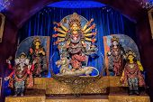 Goddess Durga Idol At Decorated Durga Puja Pandal, Shot At Colored Light, At Kolkata, West Bengal, I poster