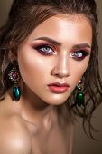 Attractive Young Model Colorful Trendy Smoky Eyes, Bright Blue Eyes, Wet Hairdo And Green Earring poster