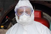 picture of ppe  - engineer ready to start cleaning an industrial steam boiler with correct ppe all in place - JPG