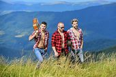 Tourists Hiking Concept. Group Of Young People In Checkered Shirts Walking Together On Top Of Mounta poster