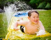 image of chute  - Happy child on water slide to cool off on hot day during spring or summer - JPG