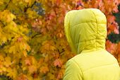 Lonely Unrecognizable Person. A Sad, Lonely Woman In The Rain In A Yellow Jacket And Hood Stands Nex poster
