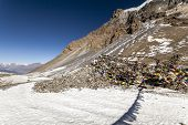 Mountain Pass Thorong La Pass (5416 M), Annapurna Trek, Himalayas. Prayer Buddhist Flags Fluttering  poster