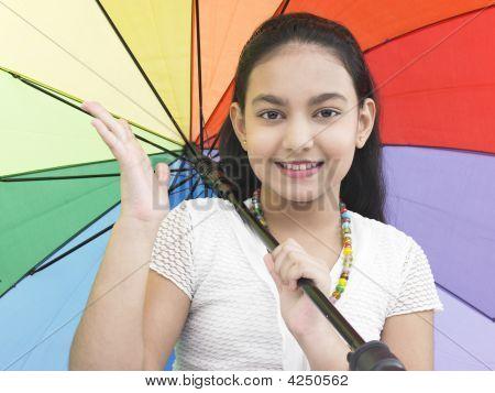 Girl Of Indian Origin With A Rainbow Umbrella