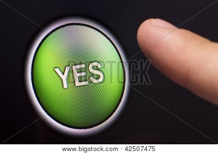 Finger Pressing A Green Yes Button On Touchscreen