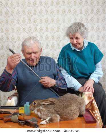 Grandparent And Rabbit Prepare Double-barreled Gun To Hunt