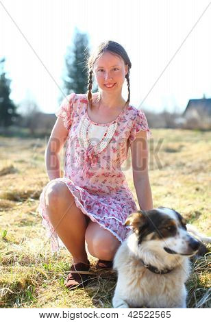 Beautiful Woman In A Sunshine With A Dog
