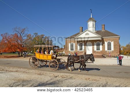 A Horse-drawn Carriage Rides In Front Of The Courthouse Building In Colonial Williamsburg, Virginia,