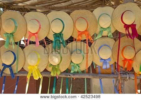 Straw Hats With Ribbons For Sale At A Stand In Colonial Williamsburg, Virginia