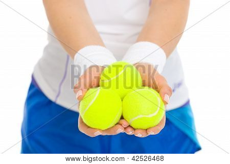 Closeup On 3 Tennis Balls In Hand Of Tennis Player
