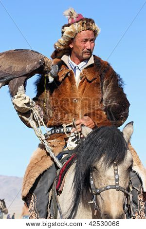 Mongolia - 25 July: The Senior Mongolian Horseman In Traditional Clothing With Golden Eagle During T