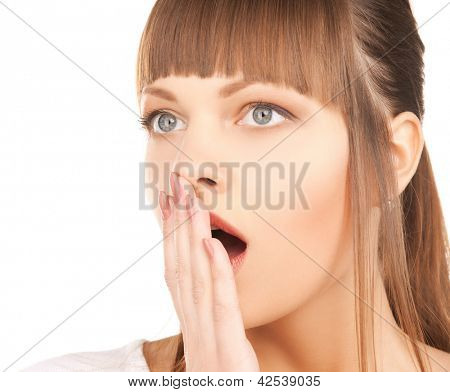 bright closeup picture of woman with hand over mouth.