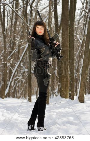 Attractive Young Lady With A Rifle