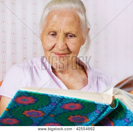 Elderly Woman With Family Album