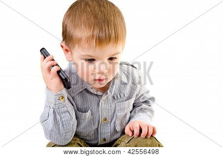 Cute little boy talking on a mobile phone