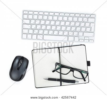 Office supplies, glasses and peripheral devices. View from above. Isolated on white background