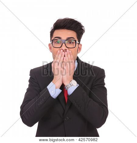 young business man covering his mouth over white background
