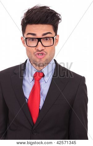 portrait of a young business man goofing around on a white background
