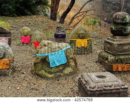 Rocks With Bibs At Temple In Kyoto, Japan