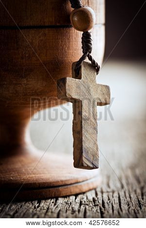 still life with wooden cross and wooden chalice