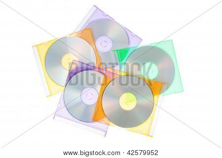 Group Disks Cd-dvd In The Boxes. On A White Background.