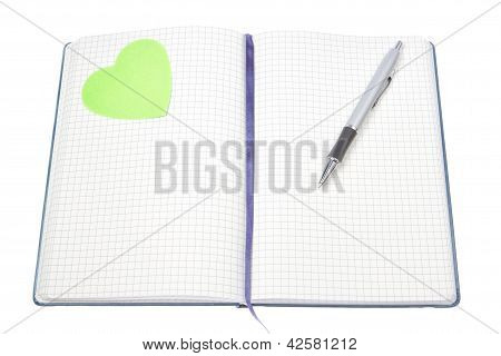 Open Notepad With A Pen And A Green Heart.