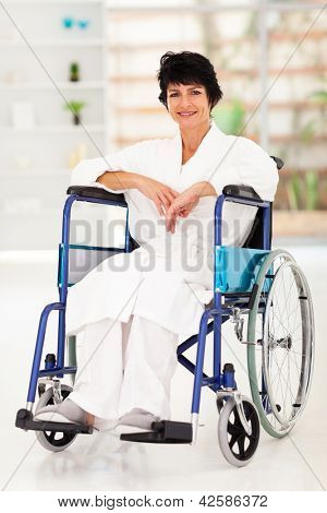middle aged woman sitting on wheelchair recovering from injury