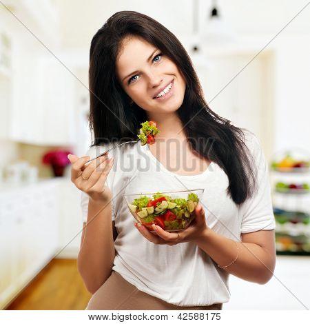 Portrait Of A Girl Looking Positive And Holding A Bawl With Salad