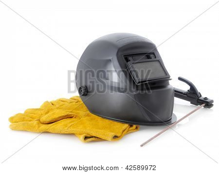 Black arc welding hood,welding electrode holder and yellow protective leather gloves over white