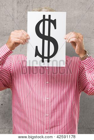 Man Hiding His Face Behind Dollar Sign On White Background