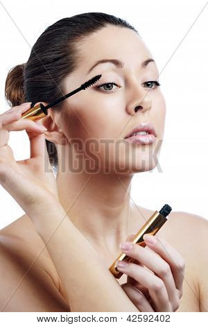 Beautiful Young Adult Woman Applying Mascara On Eyelashes