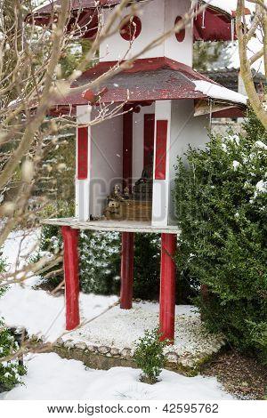 Japanese Garden During Snowfall In Winter
