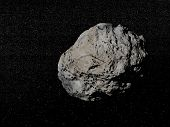 stock photo of meteorite  - Big grey meteorite in the universe full of stars - JPG