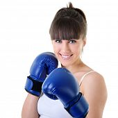 sport young woman in boxing gloves, face of fitness girl studio shot over white background