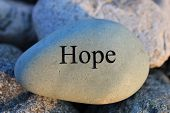 stock photo of hope  - Positive reinforcement word Hope engrained in a rock - JPG