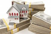 stock photo of house rent  - Stacks of One Hundred Dollar Bills with Small House - JPG