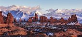stock photo of arch  - Turret Arch with Snow Mountains at sunset - JPG