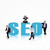 picture of handphone  - SEO (Search Engine Optimization) word surround with business people on white