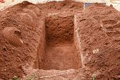 picture of burial  - Open grave freshly dug for a burial - JPG