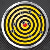 picture of shooting-range  - Yellow and black shooting range target shot full of bullet holes - JPG
