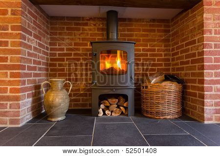 Wood Burning Stove In Brick Fireplace