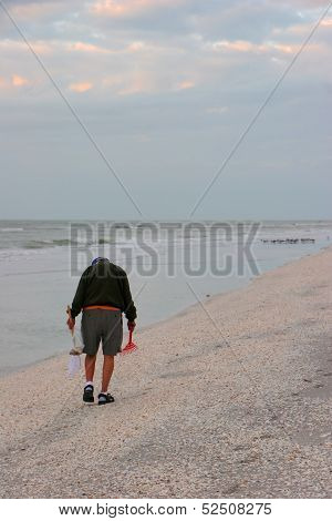 Man Searching for Shells