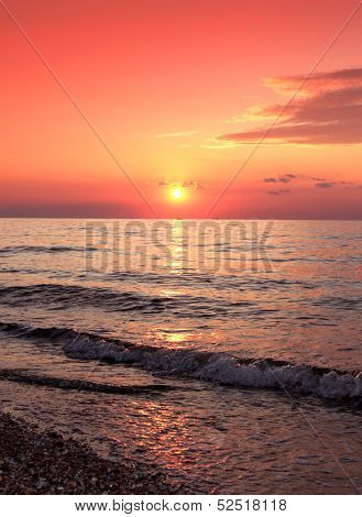 Sunset on the sea wave .